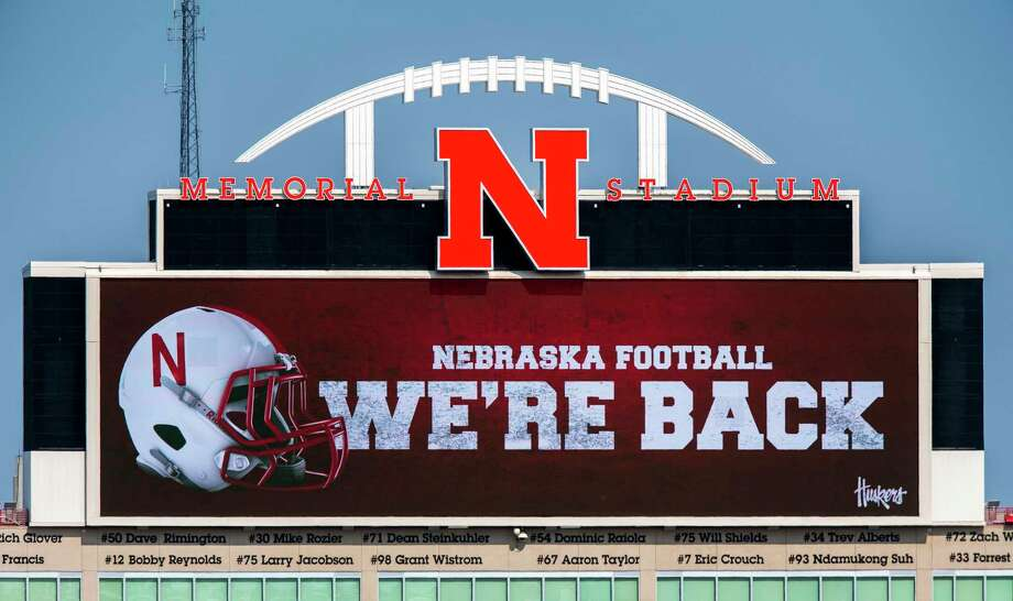 Memorial Stadium's north stadium video board projects the news of the return of Big Ten NCAA college football, Wednesday, Sept. 16, 2020, in Lincoln, Neb. Less than five weeks after pushing fall sports to spring in the name of player safety during the pandemic, the Big Ten conference changed course Wednesday and said it plans to open its football season the weekend of Oct. 23-24. (Francis Gardler/Lincoln Journal Star via AP) Photo: FRANCIS GARDLER / Associated Press / LINCOLN JOURNAL STAR