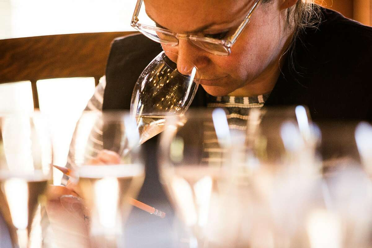 Enologist Mara Ambrose tastes different wines to determine the ideal blend at Schramsberg Vineyards in Calistoga, California on June 29, 2017.