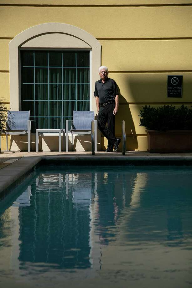 Henry Feldman stands in the pool courtyard at his hotel, La Quinta Inn & Suites by Wyndham San Antonio Medical Ctr NW, in San Antonio on Monday, Sept. 14, 2020. Photo: Lisa Krantz, Staff / Staff Photographer / San Antonio Express-News