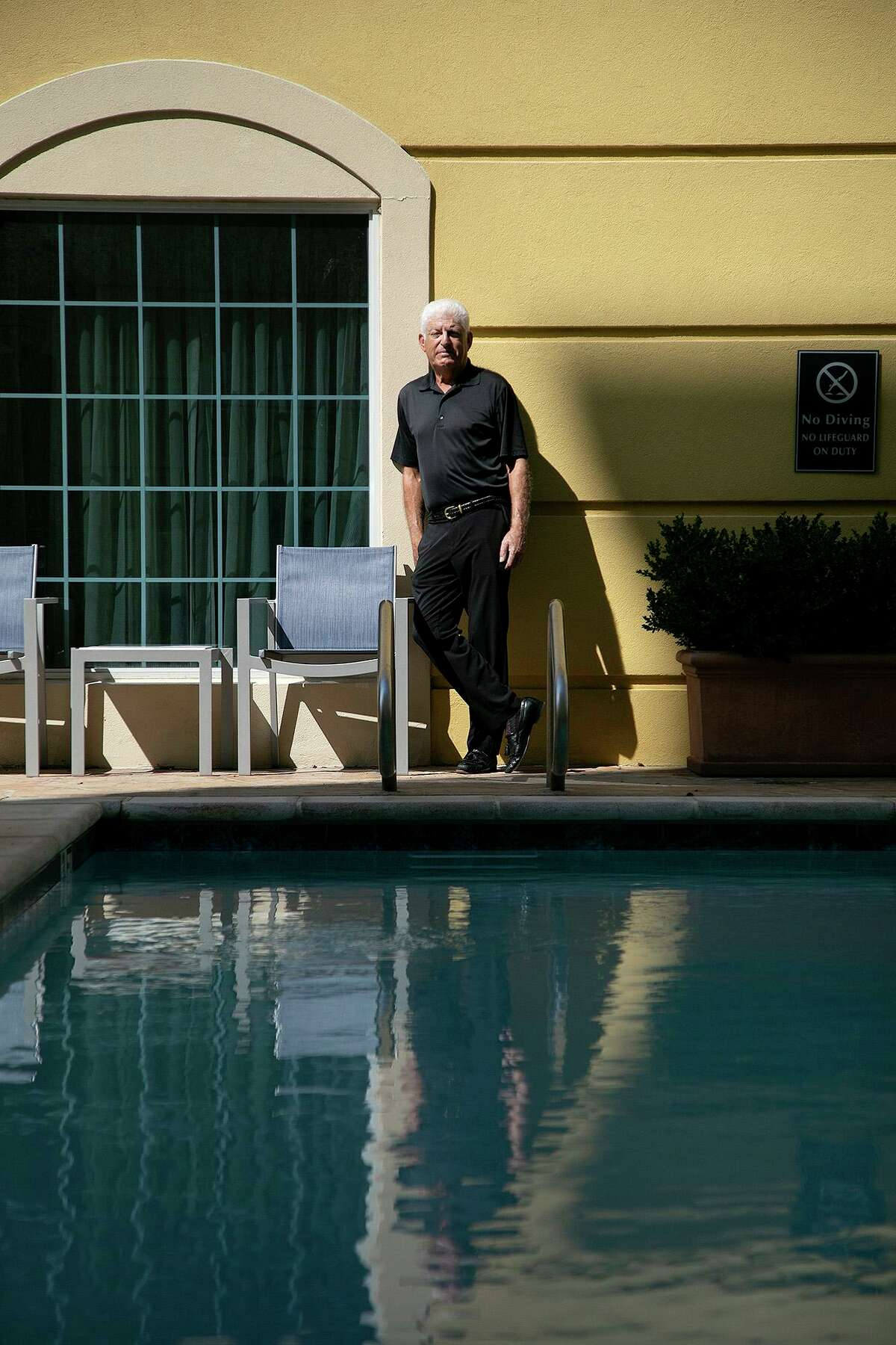Henry Feldman stands in the pool courtyard at his hotel, La Quinta Inn & Suites by Wyndham San Antonio Medical Ctr NW, in San Antonio on Monday, Sept. 14, 2020.
