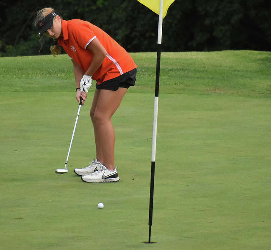 Edwardsville's Morgan Landry watches her putt on the No. 5 green at Spencer T. Olin Golf Course on Wednesday. Photo: Matt Kamp|The Intelligencer