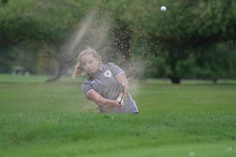 Manistee's Emalyn Nelson gets out of the trap on No. 6 at Manistee Golf & Country Club on Wednesday during the Chippewas' Lakes 8 Conference match. (Dylan Savela/News Advocate)