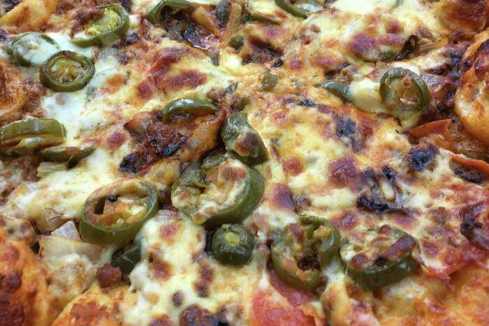 The Mexican pizza at Jimmy's Family Pizza is loaded with hot sauce, chorizo and peppers.