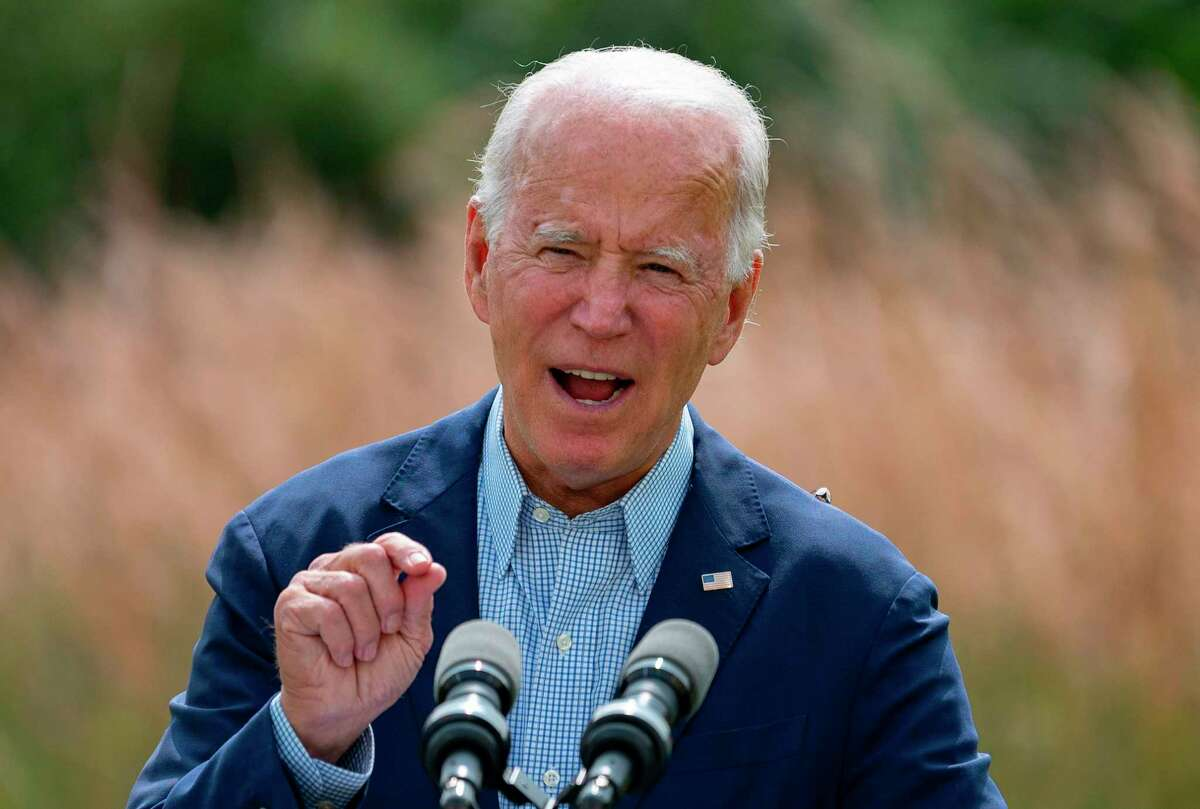 (FILES) In this file photo Democratic presidential candidate Joe Biden speaks outside the Delaware Museum of Natural History in Wilmington, Delaware, on September 14, 2020. - For the first time in its 175-year history, US magazine Scientific American has endorsed a White House candidate, saying September 15, 2020 it wanted Democrat Joe Biden to prevail because President Donald Trump