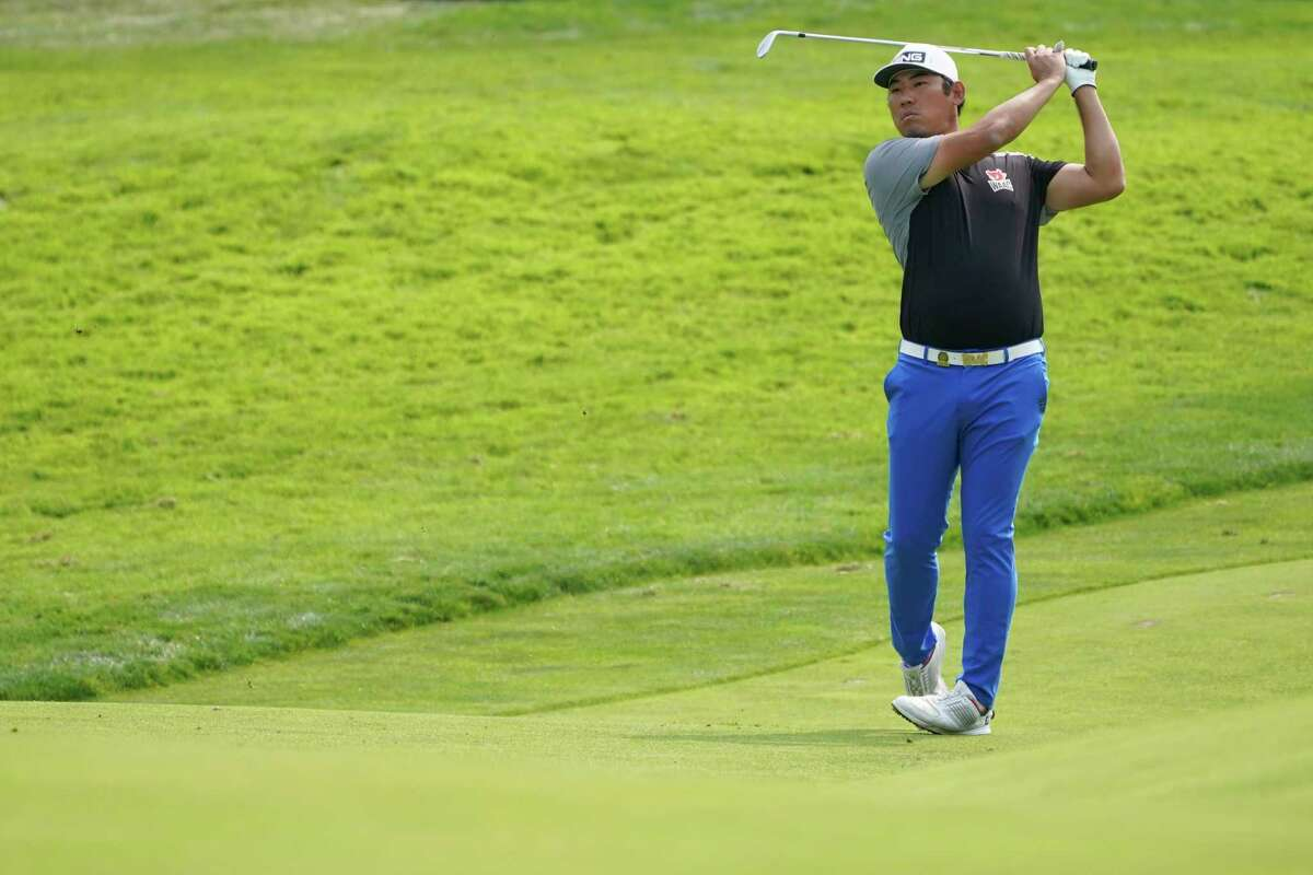 Chan Kim plays a shot on the 11th fairway during practice for the U.S. Open Championship golf tournament at Winged Foot Golf Club, Wednesday, Sept. 16, 2020, in Mamaroneck, N.Y. (AP Photo/John Minchillo)