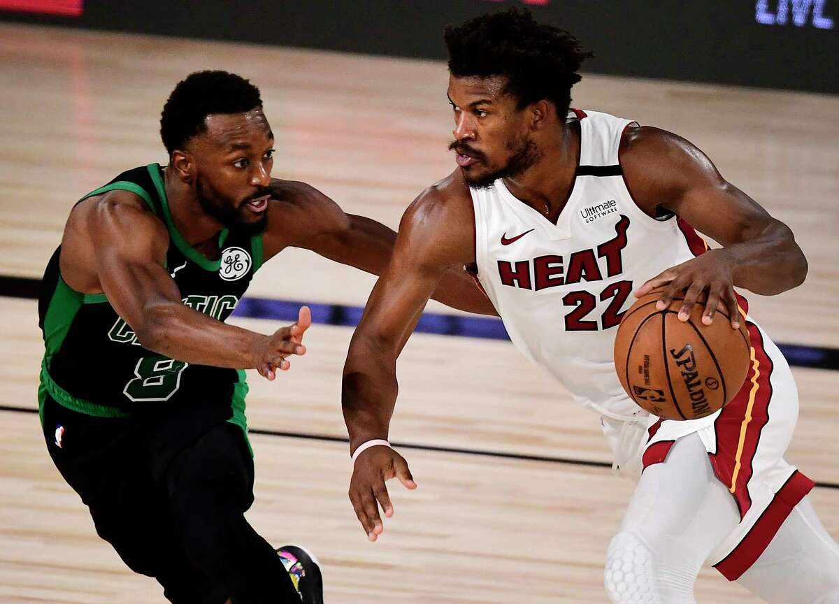 LAKE BUENA VISTA, FLORIDA - SEPTEMBER 15: Jimmy Butler #22 of the Miami Heat drives the ball against Kemba Walker #8 of the Boston Celtics during the fourth quarter in Game One of the Eastern Conference Finals during the 2020 NBA Playoffs at The Field House at the ESPN Wide World Of Sports Complex on September 15, 2020 in Lake Buena Vista, Florida. NOTE TO USER: User expressly acknowledges and agrees that, by downloading and or using this photograph, User is consenting to the terms and conditions of the Getty Images License Agreement. (Photo by Douglas P. DeFelice/Getty Images)