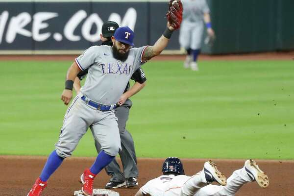 Houston Astros Kyle Tucker (30) is caught stealing second by Texas Rangers second baseman Rougned Odor (12) during the seventh inning of an MLB baseball game at Minute Maid Park, Wednesday, September 16, 2020, in Houston.