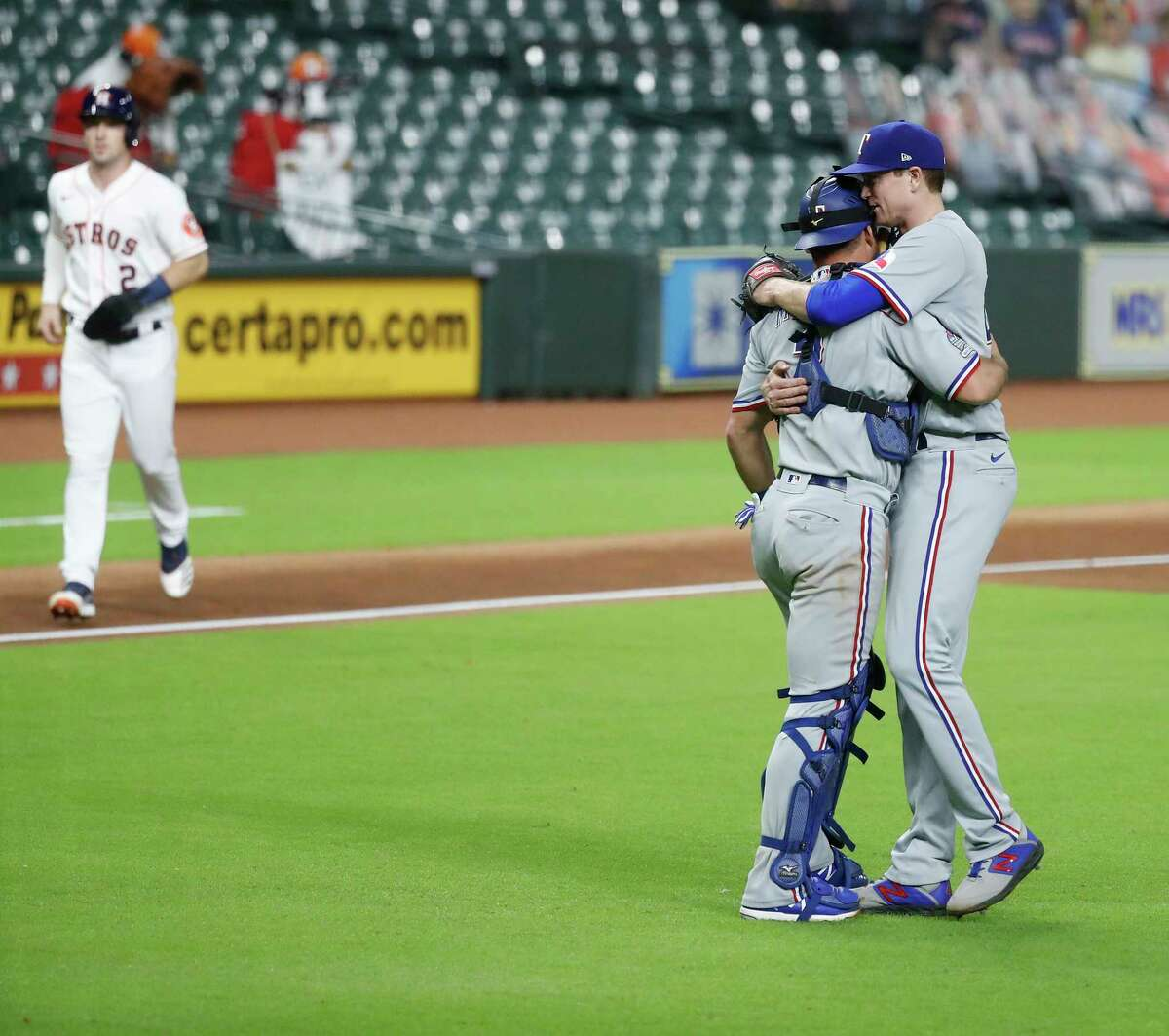 Texas Rangers starting pitcher Kyle Gibson (44) hugs catcher Jeff Mathis (2) after Houston Astros Kyle Tucker lined out to Texas Rangers first baseman Ronald Guzman, ending the game in the bottom of the ninth inning of an MLB baseball game at Minute Maid Park, Wednesday, September 16, 2020, in Houston. Texas Rangers won 1-0.