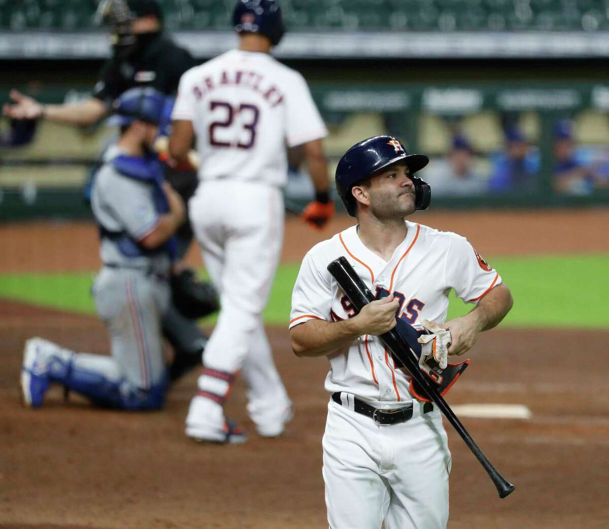 Houston Astros Jose Altuve (27) reacts after striking out during the ninth inning of an MLB baseball game at Minute Maid Park, Wednesday, September 16, 2020, in Houston.