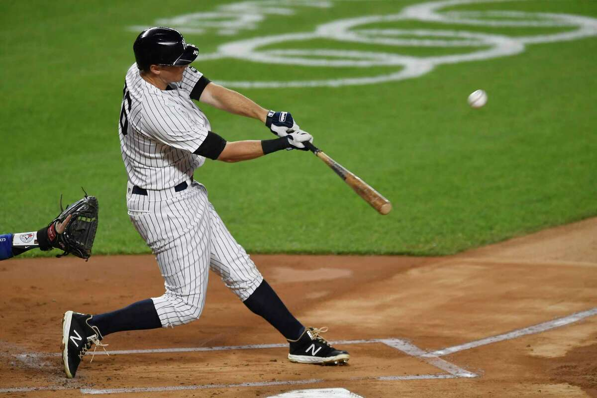 NEW YORK, NEW YORK - SEPTEMBER 16: DJ LeMahieu #26 of the New York Yankees hits a home run during the first inning against the Toronto Blue Jays at Yankee Stadium on September 16, 2020 in the Bronx borough of New York City. (Photo by Sarah Stier/Getty Images)