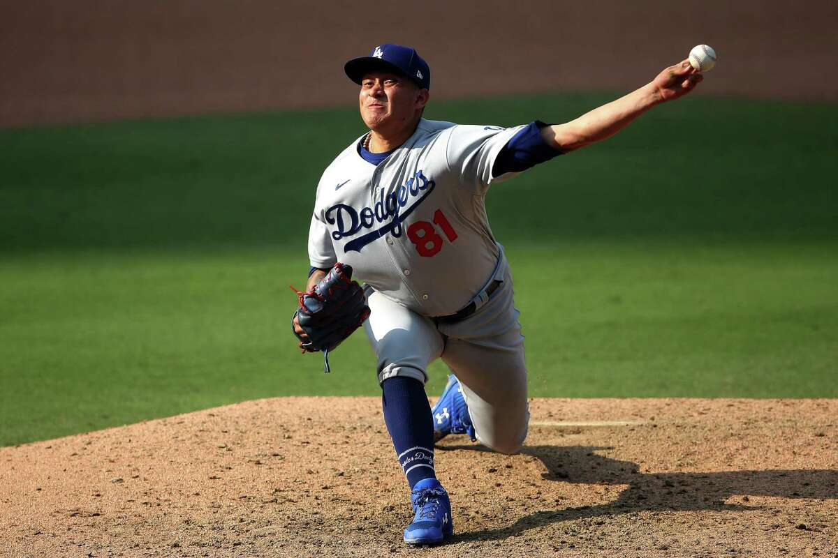 SAN DIEGO, CALIFORNIA - SEPTEMBER 16: Victor Gonzalez #81 of the Los Angeles Dodgers pitches during the ninth inning of a game against the San Diego Padres at PETCO Park on September 16, 2020 in San Diego, California. (Photo by Sean M. Haffey/Getty Images)