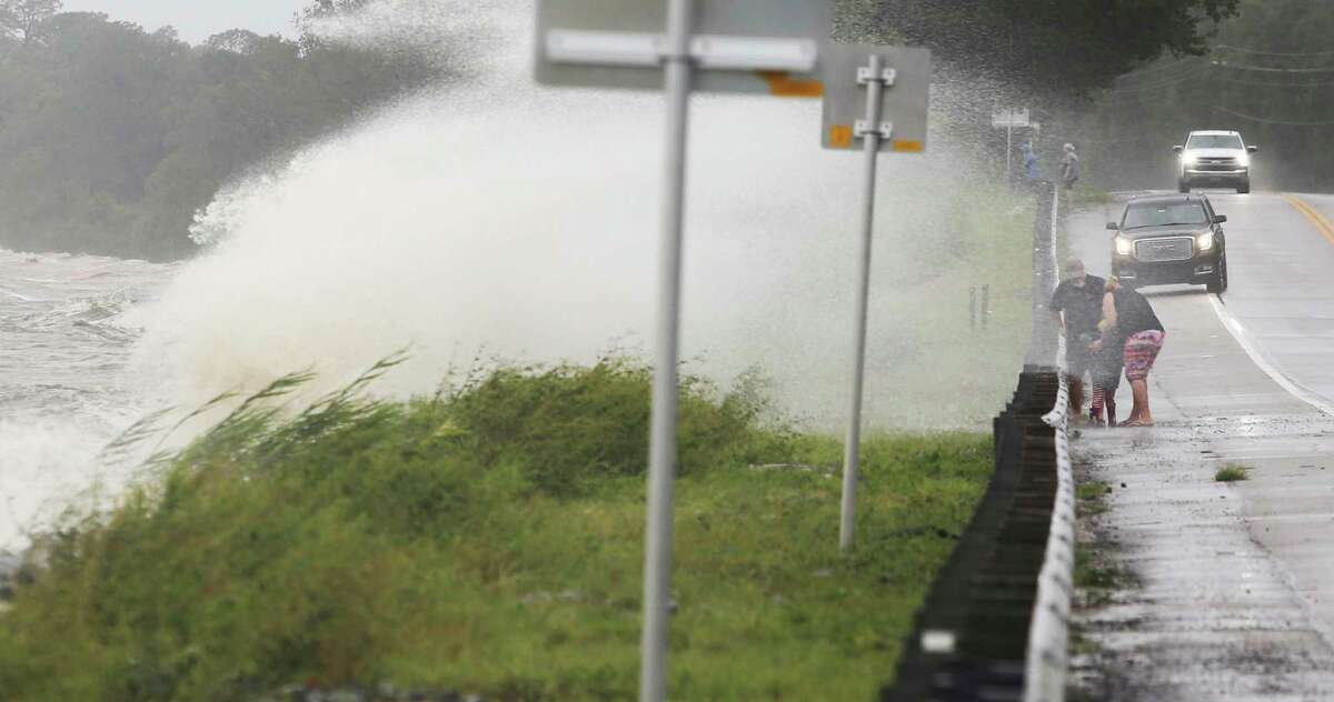 Waves crash over a seawall onto Florida State Highway 20 near Choctaw Beach, Fla., as gusty winds and heavy rains from Hurricane Sally continued to pound the Panhandle area Wednesday, Sept. 16, 2020. (Michael Snyder/Northwest Florida Daily News via AP)