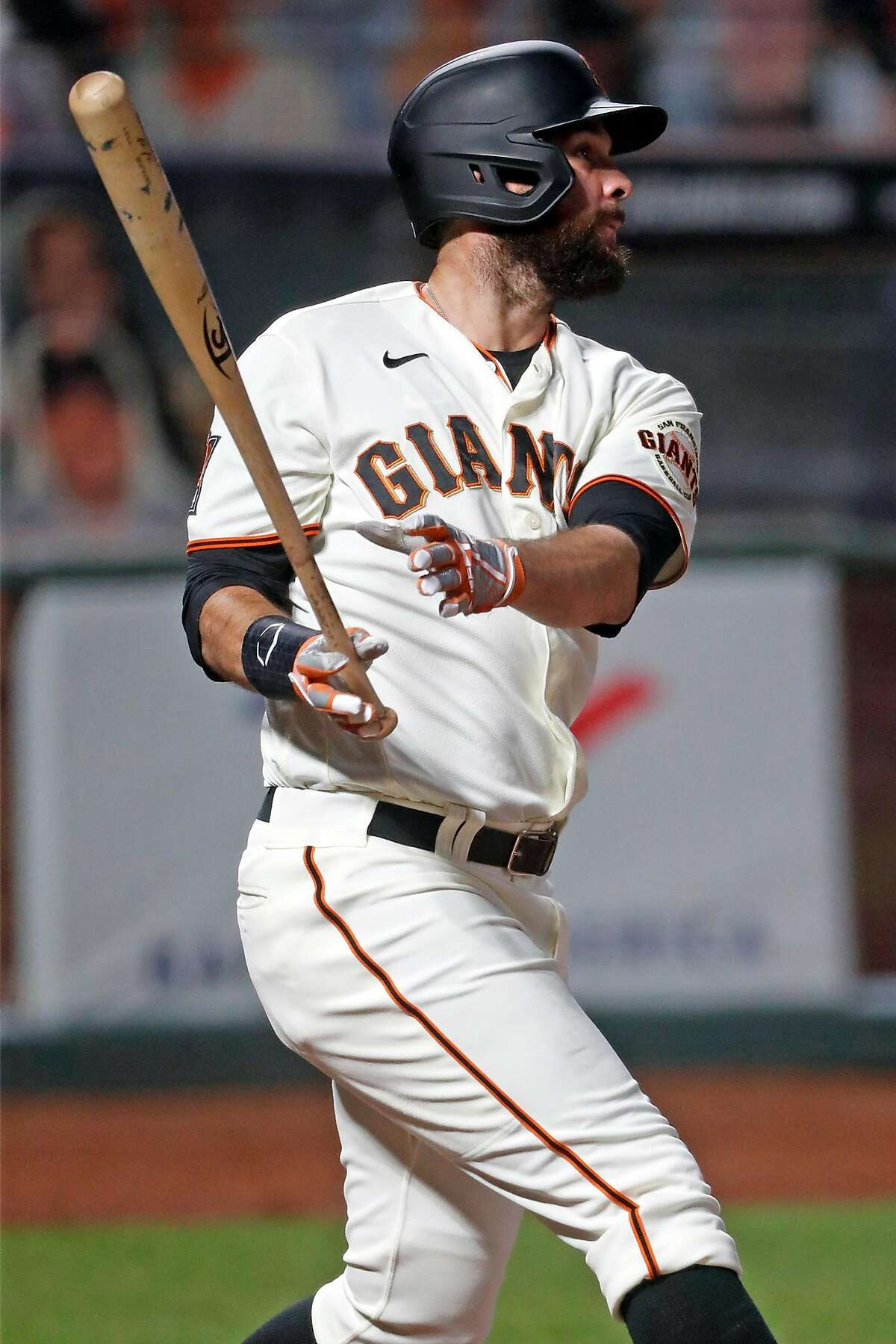 San Francisco Giants' Brandon Belt watches his 2-run home run in 3rd inning against Seattle Mariners during MLB game at Oracle Park in San Francisco, Calif., on Wednesday, September 16, 2020.