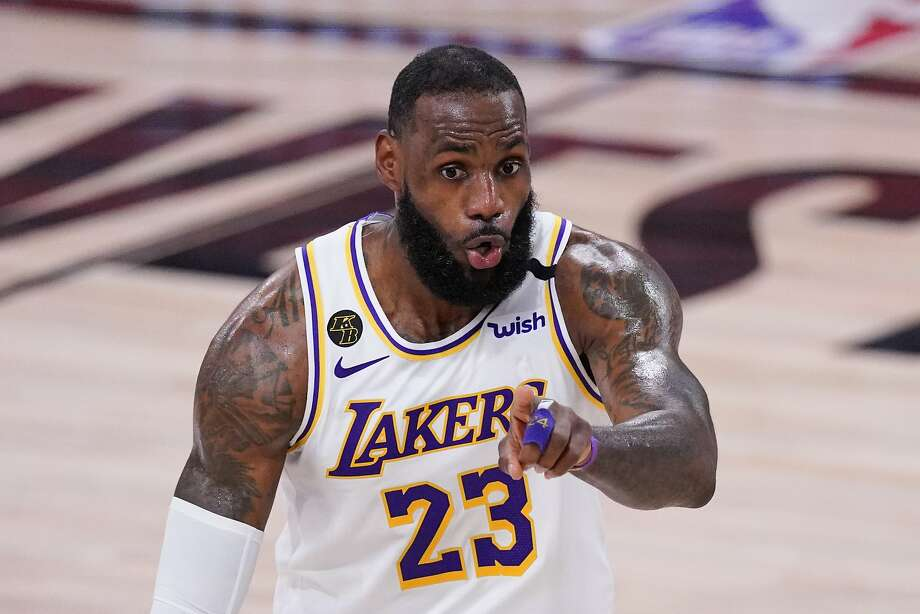 Los Angeles Lakers' LeBron James (23) signals during the second half of an NBA conference semifinal playoff basketball game against the Houston Rockets Saturday, Sept. 12, 2020, in Lake Buena Vista, Fla. (AP Photo/Mark J. Terrill) Photo: Mark J. Terrill / Associated Press