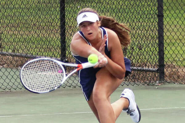 Jersey's Michelle Maag extends to return a shot during her No. 2 singles match against CM on Wednesday at Moore Park's Simpson Tennis Center in Alton.