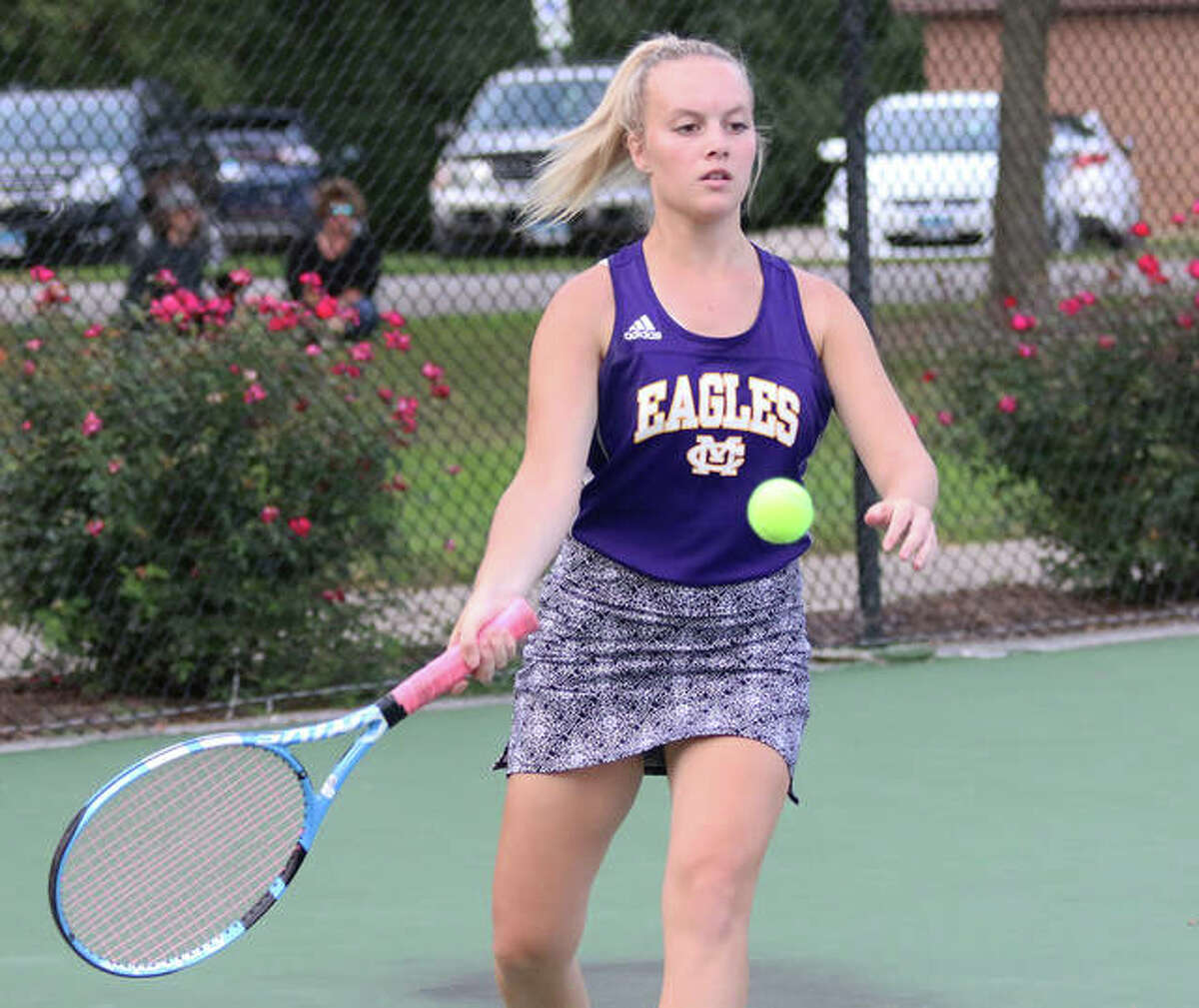 CM's Kennedy Loewen hits a return Wednesday in a No. 1 doubles match with Jersey at Simpson Tennis Center in Alton.