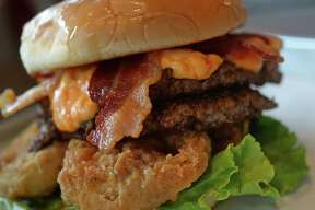 Topped with pimento cheese, fried green tomatoes and pepper jelly, Willy Burger's Hee-haw burger is a traditional burger that won a state award on the Texas Bucket List show. Photo taken Thursday, May 08, 2014 Guiseppe Barranco/@spotnewsshooter