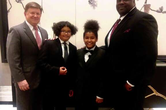(From left to right) Alief Superintendent HD Chambers with Caden, Caleb, and Derrick Bryant, their CIS Support Specialist.