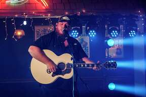 Luke Combs performs at the ACM Awards.