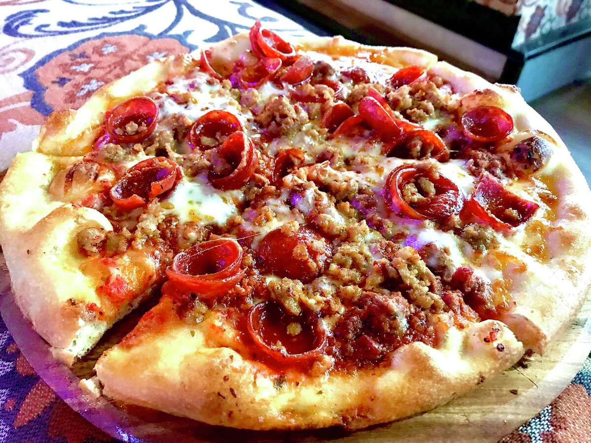 Carnivoro pizza (Italian sausage, pepperoni, bolognese and mozzarella) at Bottled Blonde Pizzeria & Beer Garden.
