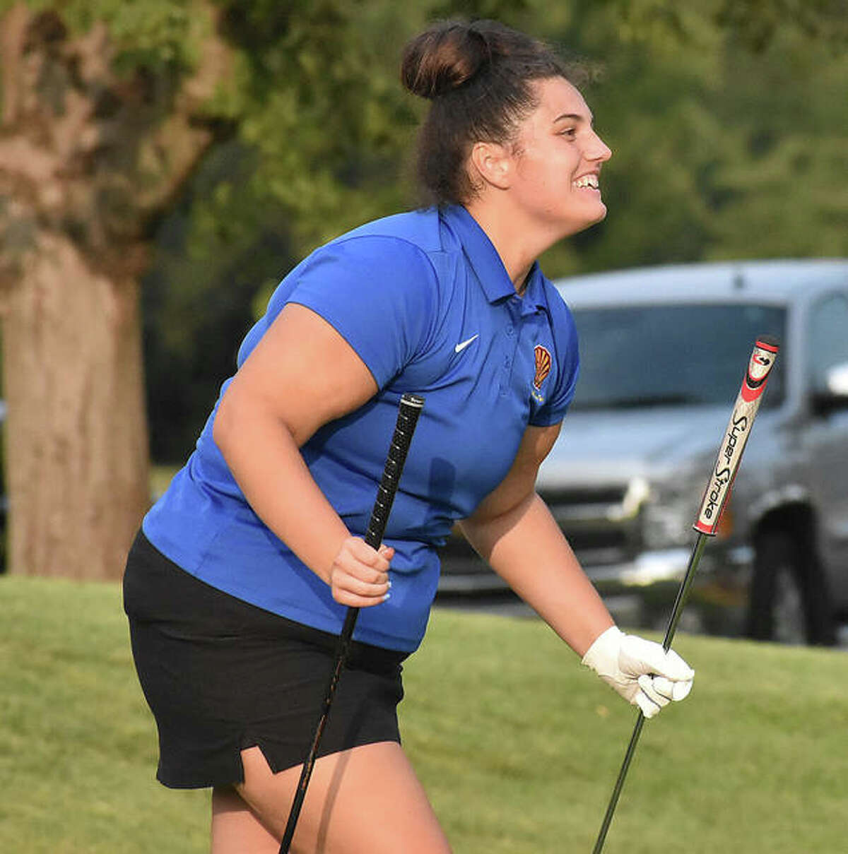Roxana's Sarah Floyd took two clubs to the ninth green at Spencer T. Olin golf course on Wednesday, but she didn't need the putter after chipping in for birdie. She reacts while walking to the cup after leading the Shells with a 46.