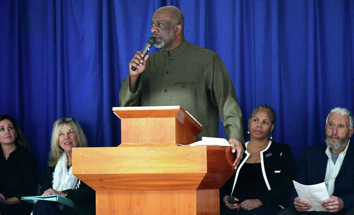 The Reverend Anthony Bennett of Mt. Aery Baptist Church in Bridgeport and Co-Chair of CONECT welcomes guests as the candidates for Norwalk's Board of Education debate a number of topics, including racial disparity in the district, Tuesday, October 29, 2019, at Grace Baptist Church in Norwalk, Conn. The debate was hosted by CONECT (Congregations Organized for a New Connecticut).