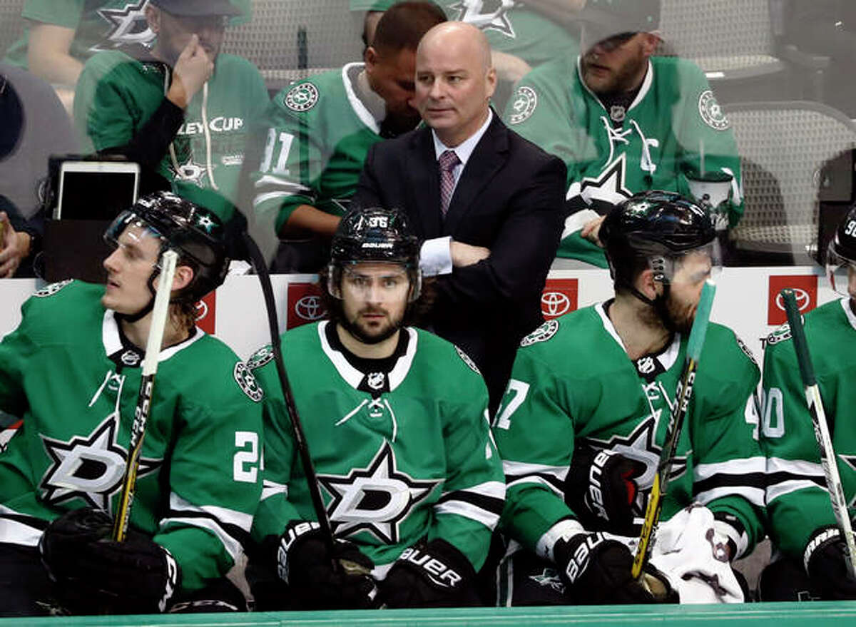 Dallas Stars coach Jim Montgomery, center rear, watches play against the Nashville Predators during the third period of Game 4 in an NHL hockey first-round playoff series in Dallas. The Blues have hired Jim Montgomery as an assistant 10 months after he was fired as coach of the Dallas Stars for unprofessional conduct.