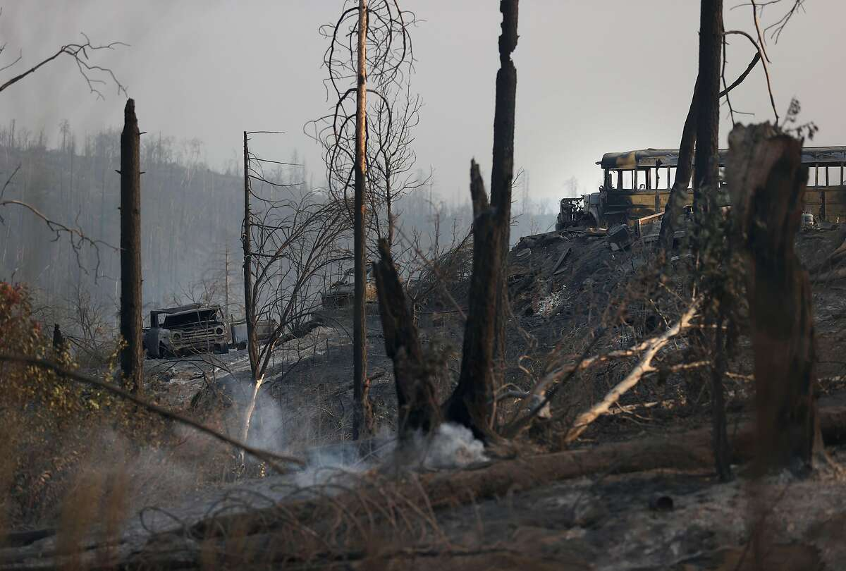 FEATHER FALLS, CALIFORNIA - SEPTEMBER 14: Cars destroyed by the Bear Fire sit next to burned trees on September 14, 2020 in Feather Falls, California. The North Complex Fire, which includes the Bear Fire, has burned over 260,000 acres and has killed at least 14 people. The complex is currently 26 percent contained. (Photo by Justin Sullivan/Getty Images)