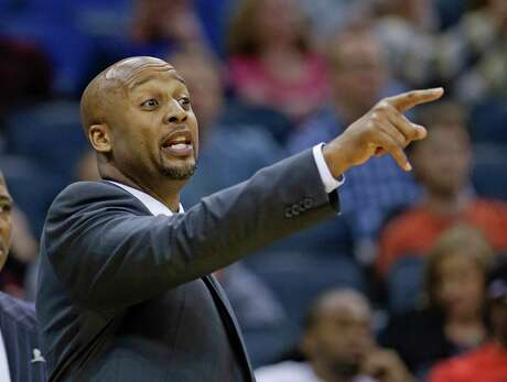Denver Nuggets head coach Brian Shaw directs his players against the Orlando Magic during the first half of an NBA basketball game in Orlando, Fla., Wednesday, March 12, 2014. (AP Photo/John Raoux)