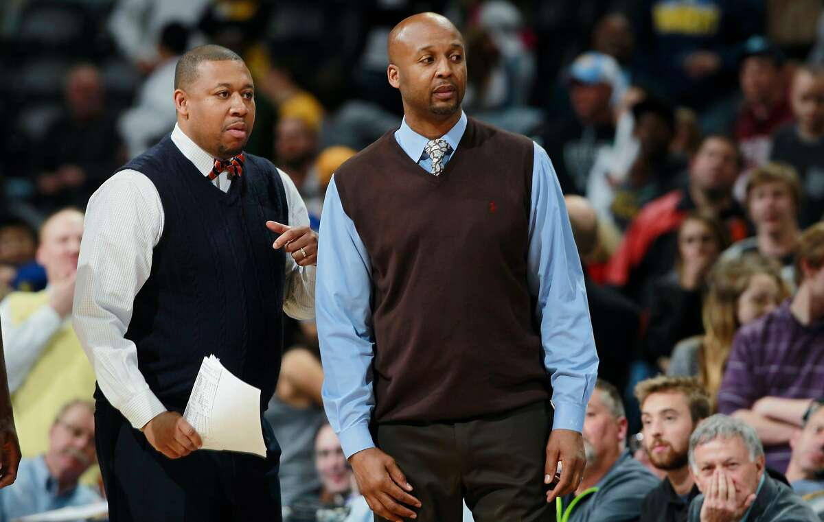 FILE - In this April 16, 2014, file photo, Denver Nuggets assistant coach Melvin Hunt, left, joins head coach Brian Shaw in contesting a call while facing the Golden State Warriors in the fourth quarter of the Warriors' 116-112 victory in an NBA basketball game in Denver. The Nuggets have fired coach Brian Shaw after 1� seasons. General manager Tim Connelly said in a statement Tuesday, March 3, 2015: