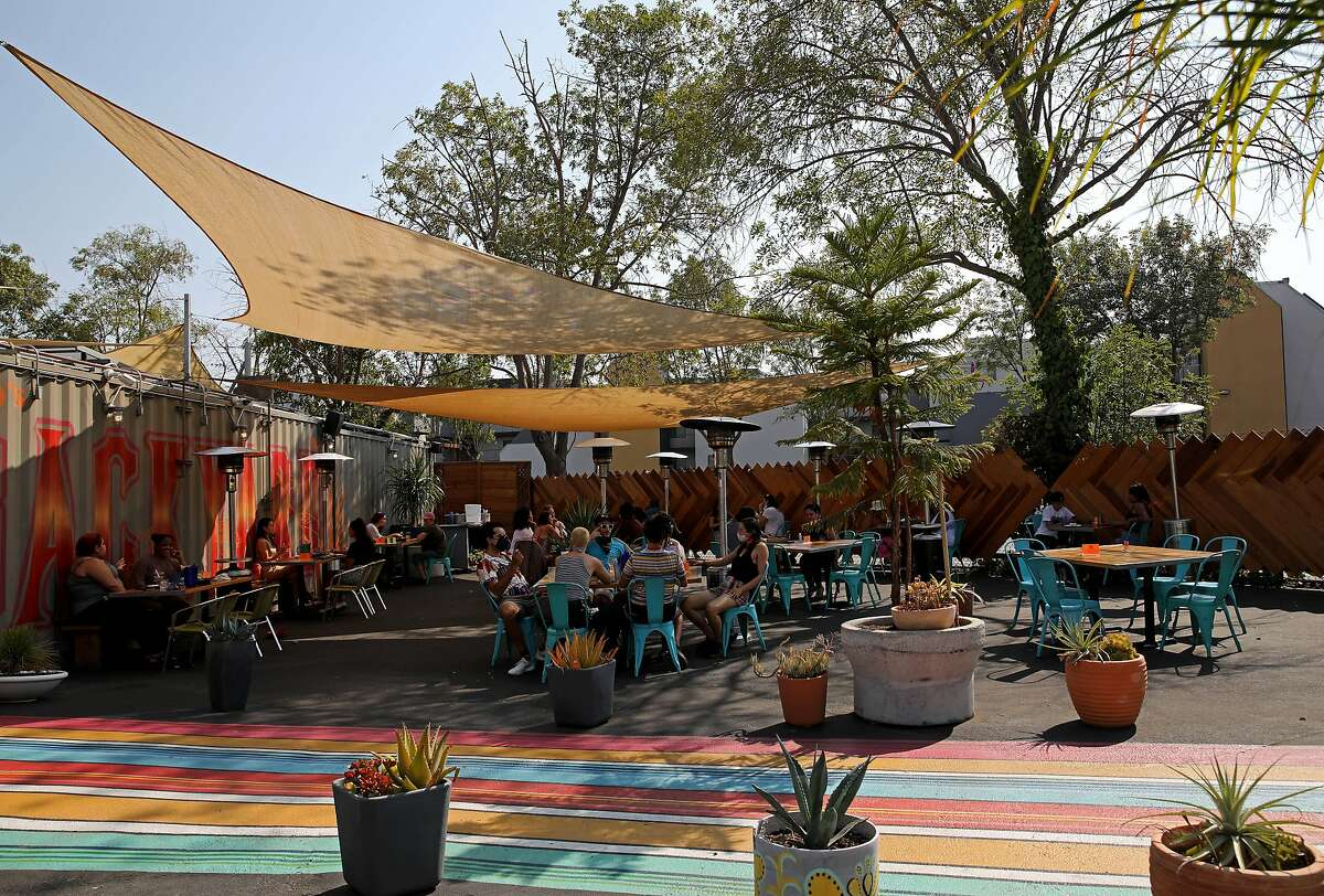 Customers have a dining experience at Nido's Backyard, located at 104 Oak St., on Saturday, September 5, 2020, in Oakland, Calif.