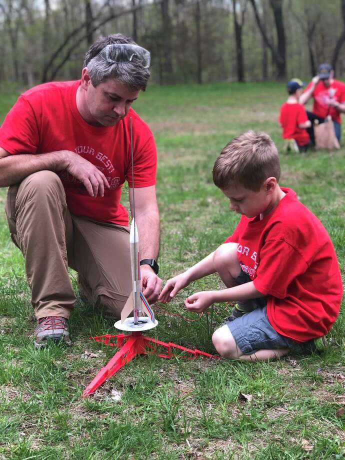 Rob Farley and his son Hudson at Cub Scout Pack 56 Rocket Day. Photo: Contributed