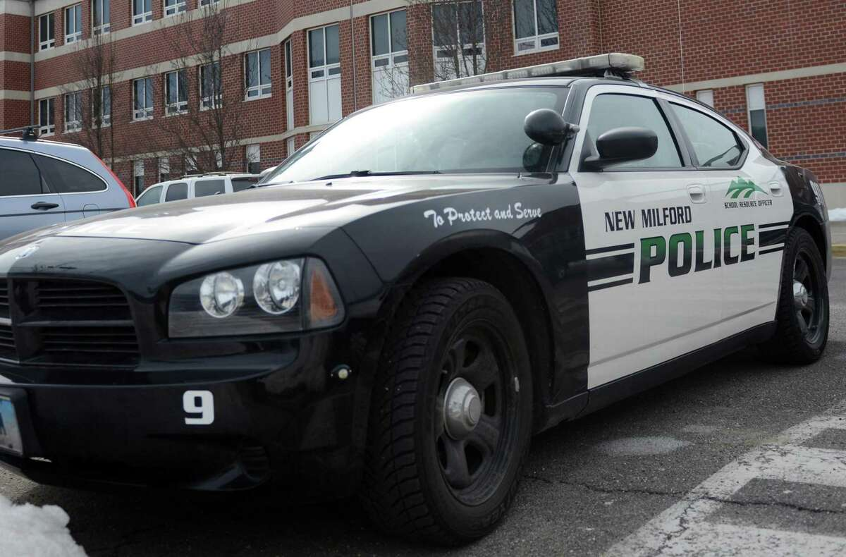A New Milford police car is parked outside during school dismissal at New Milford High School in 2014.