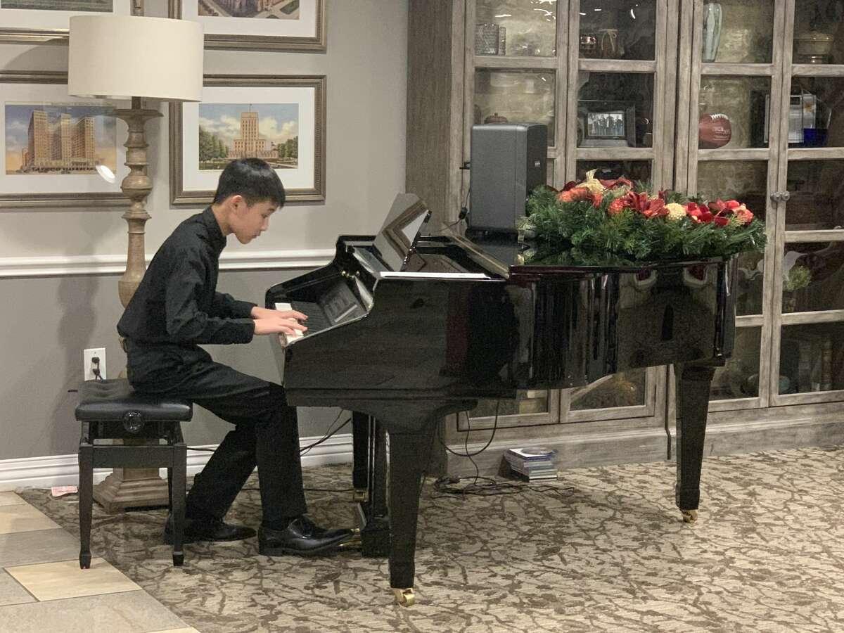 Weillison Hsu playing piano at a Houston nursing home.
