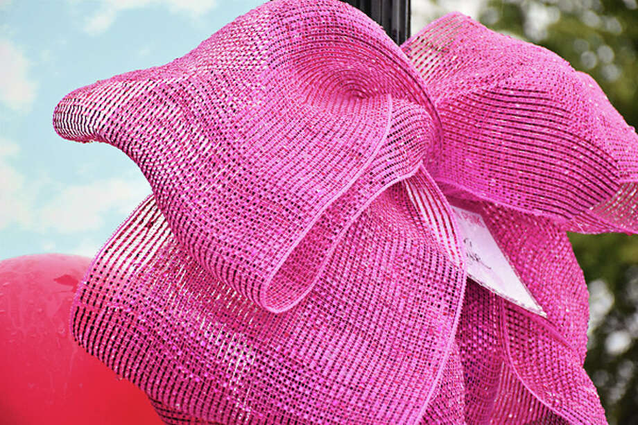 For a donation, members of the public can have a name placed on one of the large pink bows that will adorn light posts in downtown Manistee from Oct. 1-15. Photo: Courtesy Photo