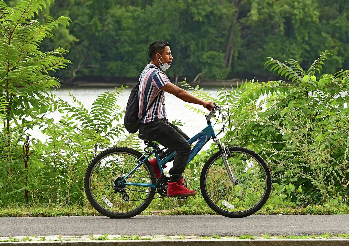 A man rides a bicycle along the Mohawk-Hudson Bike Trail at the Corning Preserve on Thursday, Sept. 17, 2020 in Albany, N.Y. (Lori Van Buren/Times Union)