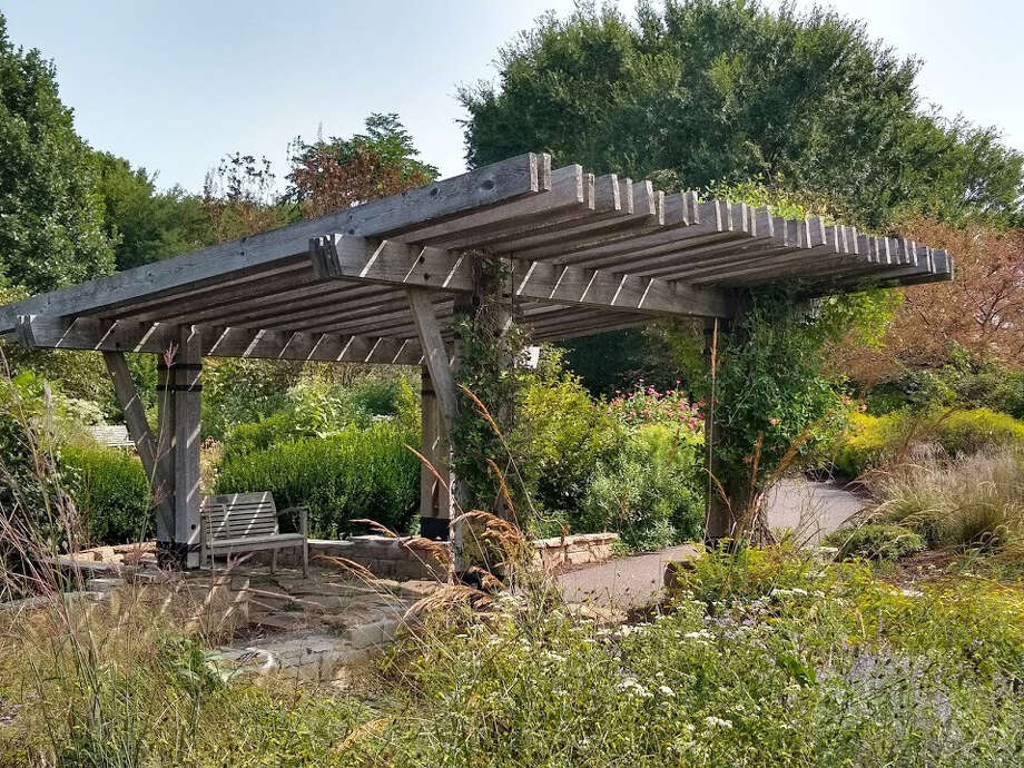 Visitors can find a shady spot to rest under the arbor at the Prairie Portal at The Gardens at SIUE. Photo: Photos Courtesy Of The Gardens At SIUE