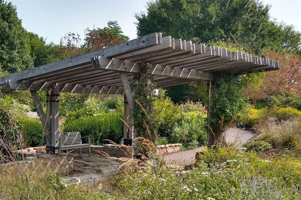 Visitors can find a shady spot to rest under the arbor at the Prairie Portal at The Gardens at SIUE.