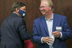 Graham Weston, right, Chairman of Community Labs, bumps elbows with Bruce Bugg Jr. Vice Chairman of Community Labs, a new nonprofit as they announced that it will deliver faster local results of coronavirus tests, on Thursday, Sept. 17, 2020.