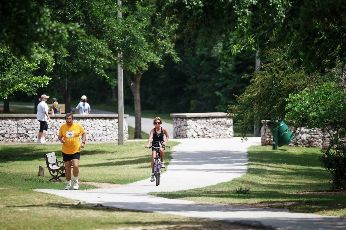 People exercise along the Terry Hershey Park Hike & Bike Trail, Monday, April 29, 2013, in Houston. ( Michael Paulsen / Houston Chronicle )