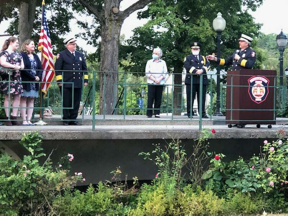 Jamie Lagassie, far right, speaks during his swearing-in ceremony as the new chief of the Winsted Fire Department ceremony, held Wednesday in East End Park. Also pictured is Mayor Candy Perez, center, Winchester Police Chief William Fitzgerald Jr., second from right, and Chief David Sartirana, left. Photo: Candy Perez / Contributed Photo /