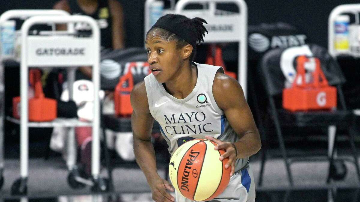 Minnesota Lynx guard Crystal Dangerfield brings the ball up the court during the first half of a WNBA basketball game against the Las Vegas Aces, Thursday, Sept. 10, 2020, in Bradenton, Fla.