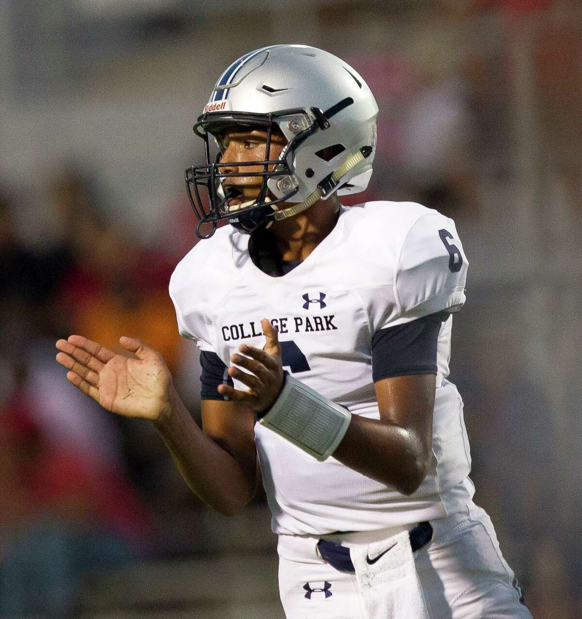 College Park quarterback Ty Buckmon (6) reacts after throwing a 9-yard touchdown pass to tight end Cody Mladenka during the third quarter of a non-district high school football game at W.W. Thorne Stadium, Saturday, Sept. 7, 2019, in Houston.