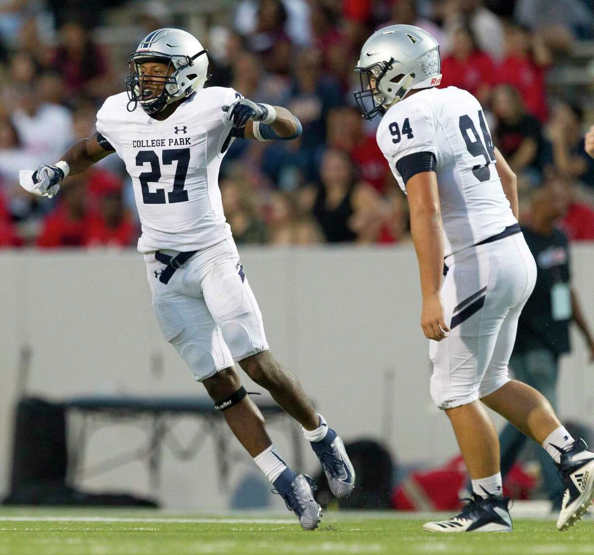 College Park defensive back Curt Evangelister (27) reacts after intercepting a pass by Aldine MacArthur quarterback RaShaun Jackson during the third quarter of a non-district high school football game at W.W. Thorne Stadium, Saturday, Sept. 7, 2019, in Houston.
