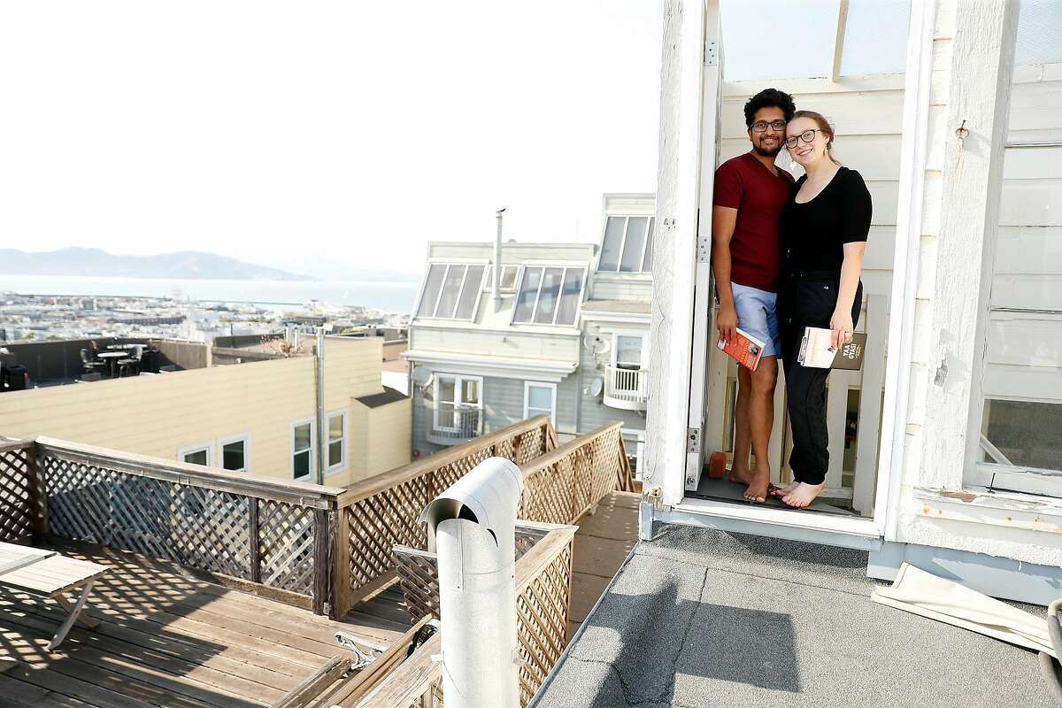 Santosh Vadlamani and Ally Sillins on the roof of their home in San Francisco, Calif., on Wednesday, September 16, 2020. The couple have bucked the trend by purchasing a home in San Francisco.