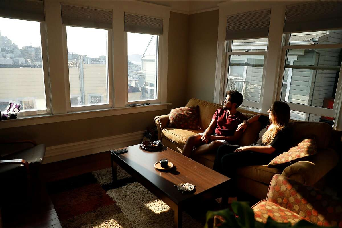 Santosh Vadlamani and Ally Sillins in the living room of their home in San Francisco, Calif., on Wednesday, September 16, 2020. The couple have bucked the trend by purchasing a home in San Francisco.