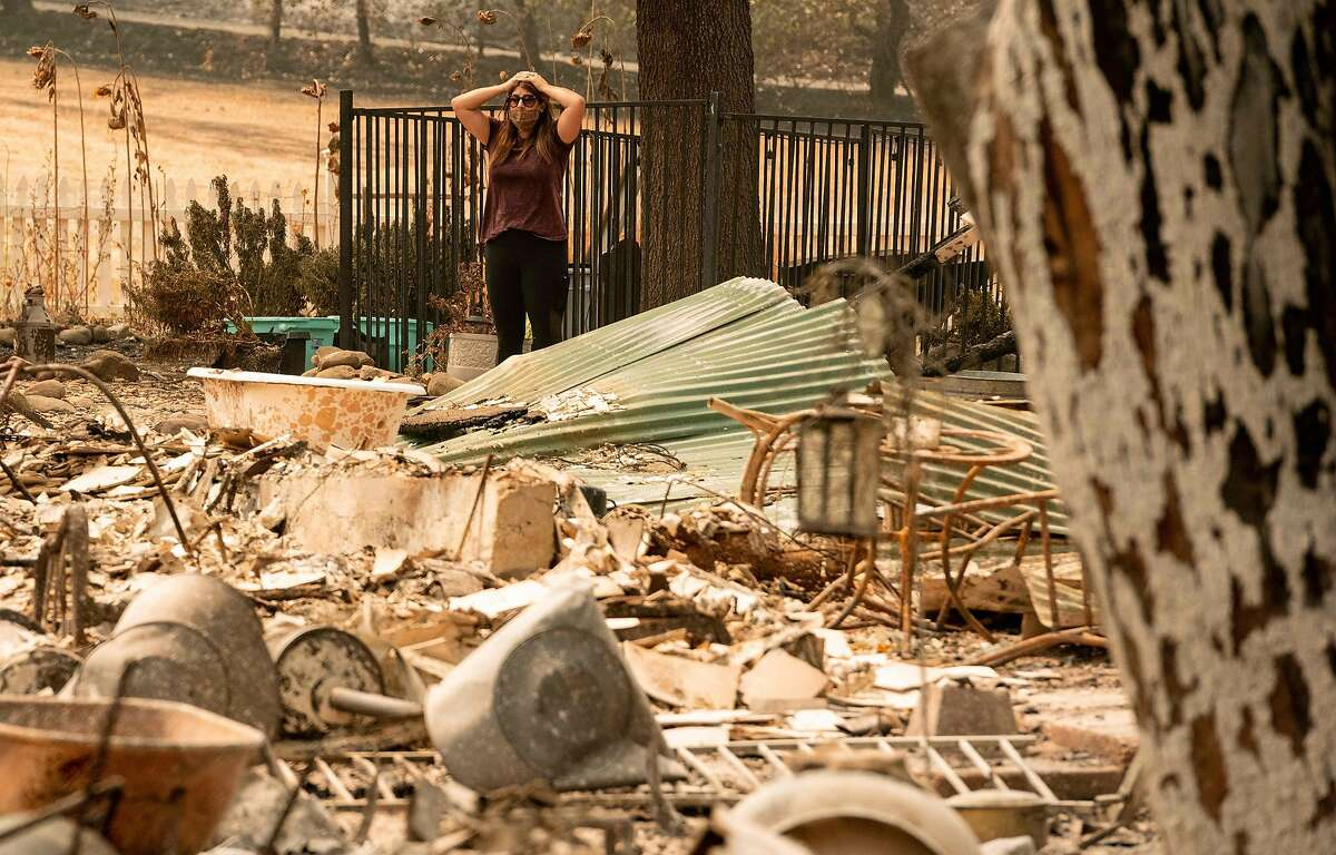 TOPSHOT - Resident Alyssa Medina reacts while looking over the charred remains of her family home during the LNU Lightning Complex fire in Vacaville, California on August 23, 2020. - Firefighters battled some of California's largest-ever fires that have forced tens of thousands from their homes and burned one million acres, with further lightning strikes and gusty winds forecast in the days ahead. (Photo by JOSH EDELSON / AFP) (Photo by JOSH EDELSON/AFP via Getty Images)