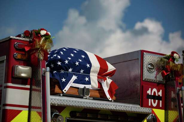 The casket of Houston Firefighter Paramedic Jerry Pacheco is taken to his memorial service at the Houston First Baptist Church on Saturday, Aug. 8, 2020, in Houston.