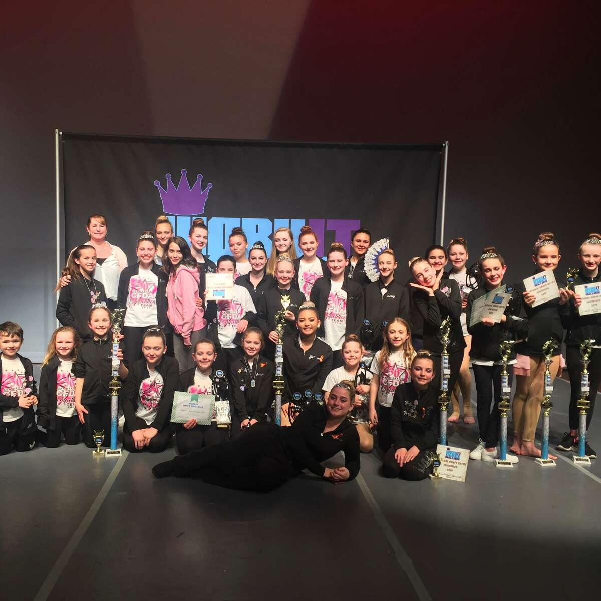 Students from the Center for Dance Arts in Torrington gather for a photo after their 2019 competition. The dance school reopened in June after the pandemic March shutdown, but owner Yvonne Donaghy says it's been a difficult challenge providing lessons for her students while complying with the state's restrictions and constant changes.
