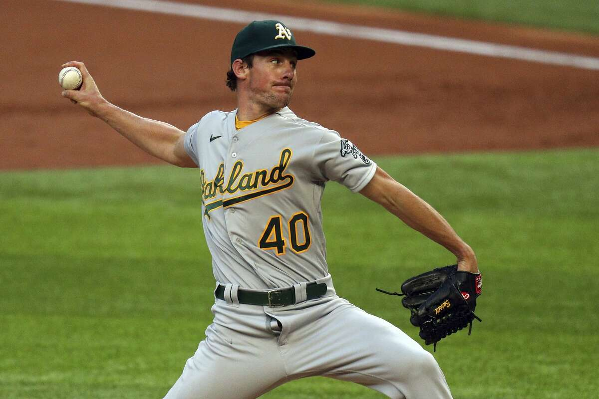 Oakland Athletics starting pitcher Chris Bassitt works the first inning in the second baseball game of a doubleheader against the Texas Rangers on Saturday, Sept. 12, 2020, in Arlington, Texas. (AP Photo/Richard W. Rodriguez)